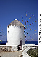 windmill in the port of parikia on the island of paros greece