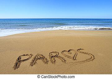 Paros written on sandy beach