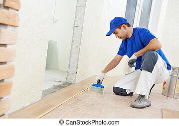 parqué, trabajador, añadir, pegamento, en, piso