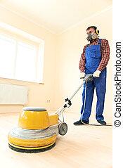 Parquet Floor maintenance by grinding machine - Worker...