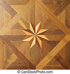 Parquet star - Decorative star at hard wood parquet floor