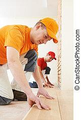 parquet workers at flooring work - Two parquet carpenter ...