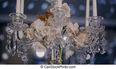 Parralax low angle shot of table candelabra centerpieces decoradet with flowers
