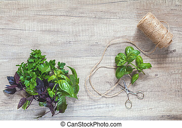 Parsley and basil bunch of bouquets, scissors and rope cord...