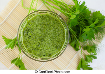 parsley and celery juice in glass on  table