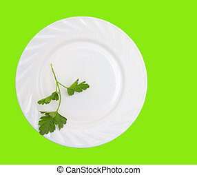 parsley on a plate on a green background
