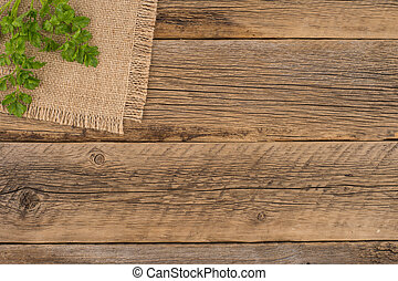 parsley on an old wooden table.