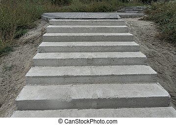 part of a concrete staircase with gray steps
