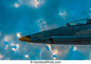 Part of a jet fighter monument against dramatic sky at...