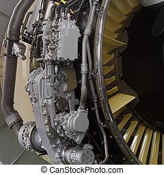 Part of a modern aircraft engine closeup.
