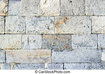 Part of a old stone wall, for background or texture.