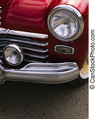 part of a red classic vintage car
