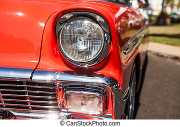 Part of a red old car with headlamp - Close-up photo of...