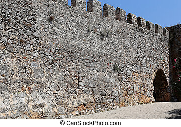 part of a stone wall with gate