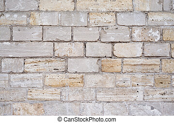 Part of a uneven stone wall with cement