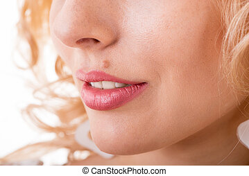 part of a woman's face with a mole close-up