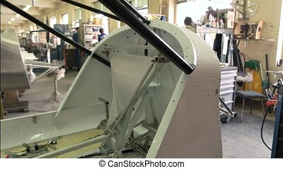 Part of airplane in workshop. Aircraft cockpit during...