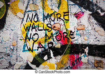 Part of Berlin Wall with graffiti and chewing gums - Part of...