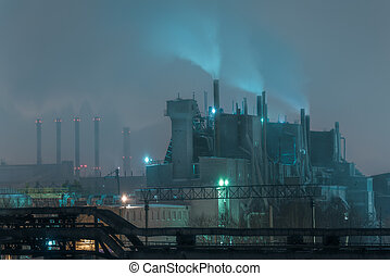 Part of big oil refinery in a foggy full moon night