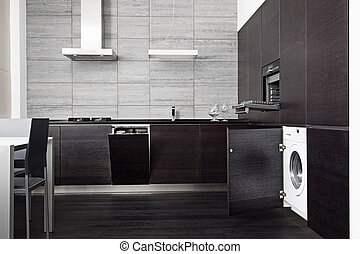 Part of black hardwood kitchen with build-in domestic...