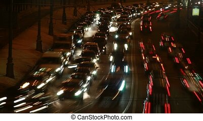 Part of brisk night movement of cars on modern highway. Time lapse.