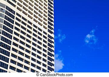 Part of building against blue sky