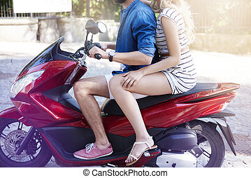 Part of couple on the motorbike