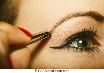 part of face woman plucking eyebrows