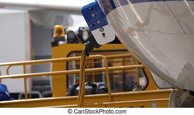 Part of fuselage with ground power wire. Bags move out the...