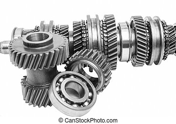 part of gearbox on black and white
