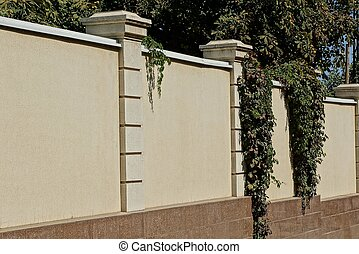 part of gray brown fence wall