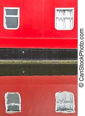Part of house boat reflecting in the water