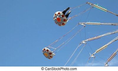 Part of merry-go-round on sky. - Part of merry-go-round on...