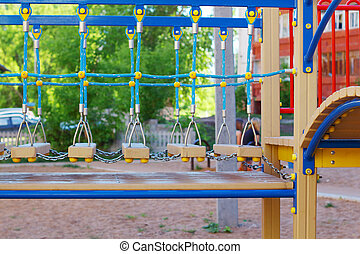 Part of modern colorful children playground at summer sunny day