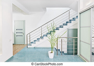 Part of modern hall interior with metal staircase in minimalism style