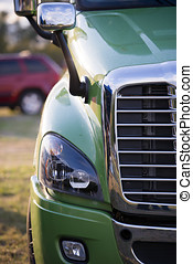 Part of modern semi truck with grille and headlight - Chrome...