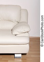 Part of modern white leather sofa