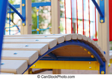 Part of modern wooden children playground at summer sunny day