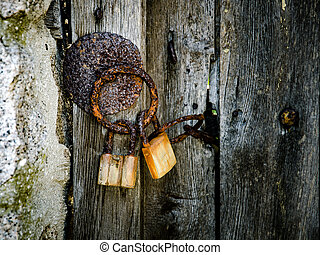 part of old wooden door with rusted iron ring