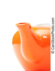 Part of Orange Ceramic Teapot closeup on white background