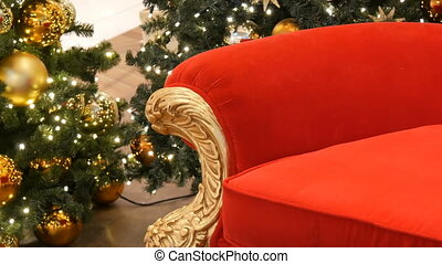 Part of Red chair of Santa Claus or St. Nicholas near...