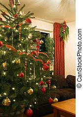 Part of room with decorated christmas tree