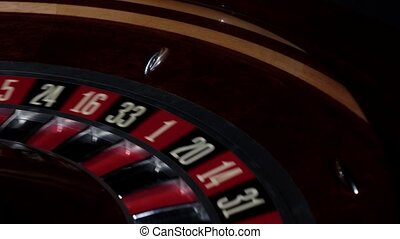 Part of roulette wheel running, numbers, close up