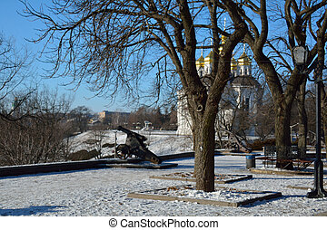 part of the alley in the Val park, with the cannon and the church, Chernihiv, Ukraine