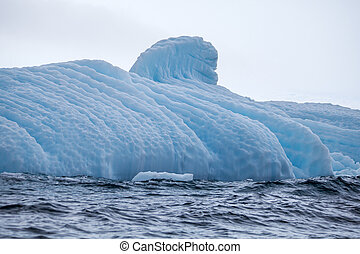 Part of the big beautifull larger iceberg in ocean, Antarctica