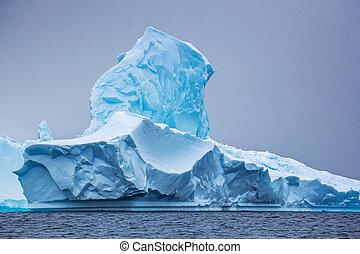 Part of the blue beautifull larger iceberg in ocean, Antarctica