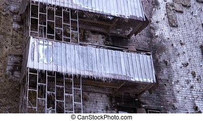 Part of the building damaged by fire. Burned-out hostel.