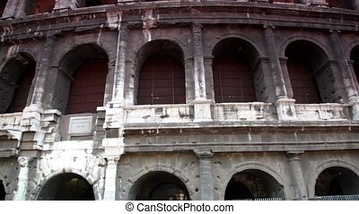 Part of the Coliseum exterior shown in motion, then shows...
