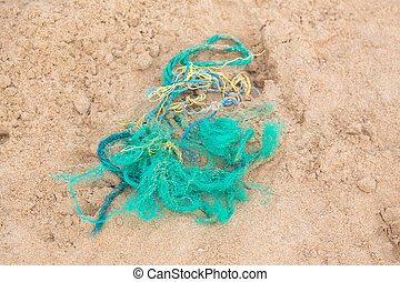 Part of the fishing net on the sandy beach.