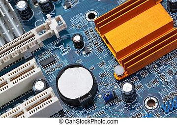 Part of the motherboard of the computer with battery and radiator.